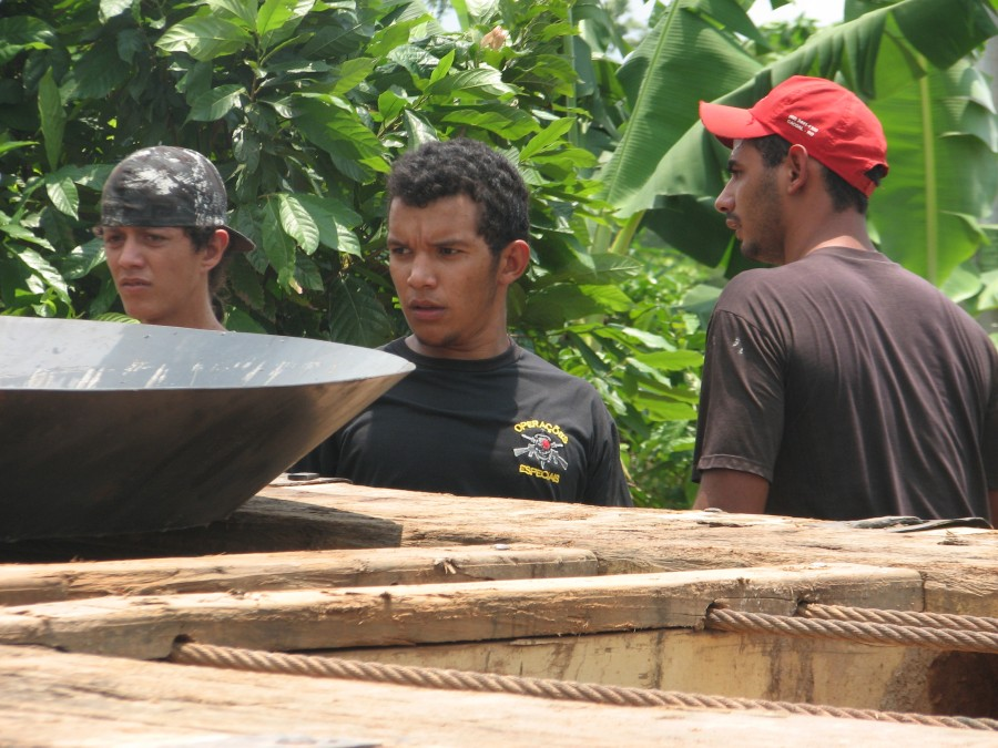 photo of loggers with gold pan